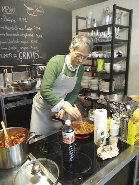 artist Kim cooking